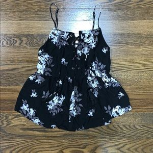 Black tank top with white floral print